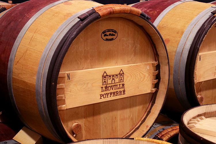 An oak wine barrel in the barrel room at Château Léoville-Poyferré