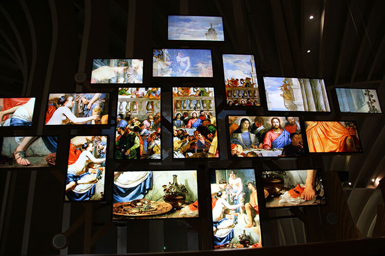 An animated collage of wine in famous artworks at La Cité du Vin