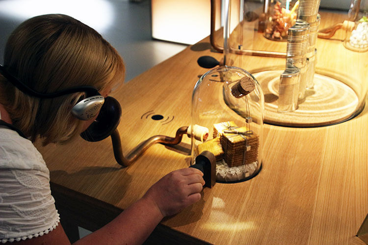 Jennifer sniffs red wine aromas from one of the exhibits at La Cité du Vin
