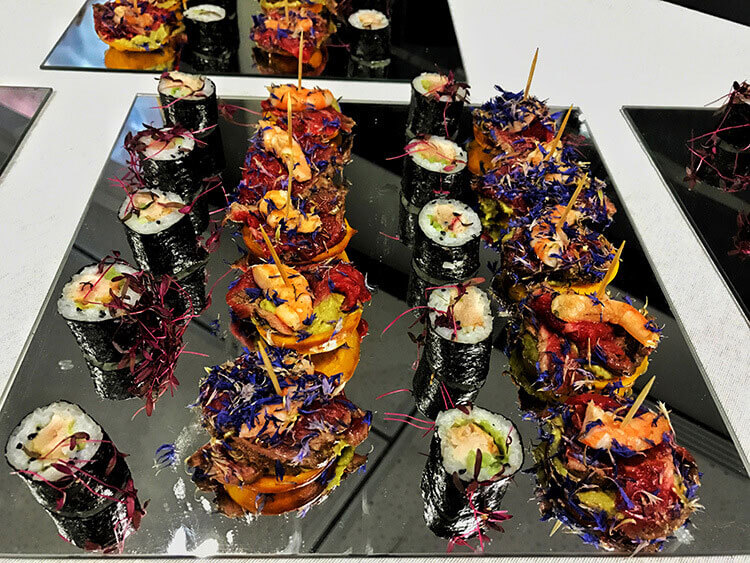 An appetizer platter of sushi and potato pancakes topped with beef or shrip at Ciné Gourmand at La Cite du Vin