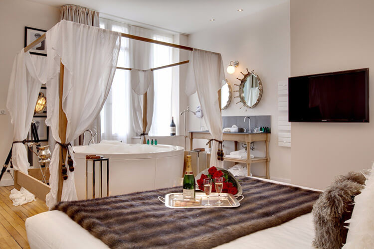 A junior suite with jacuzzi bath at Le Boutique Hotel
