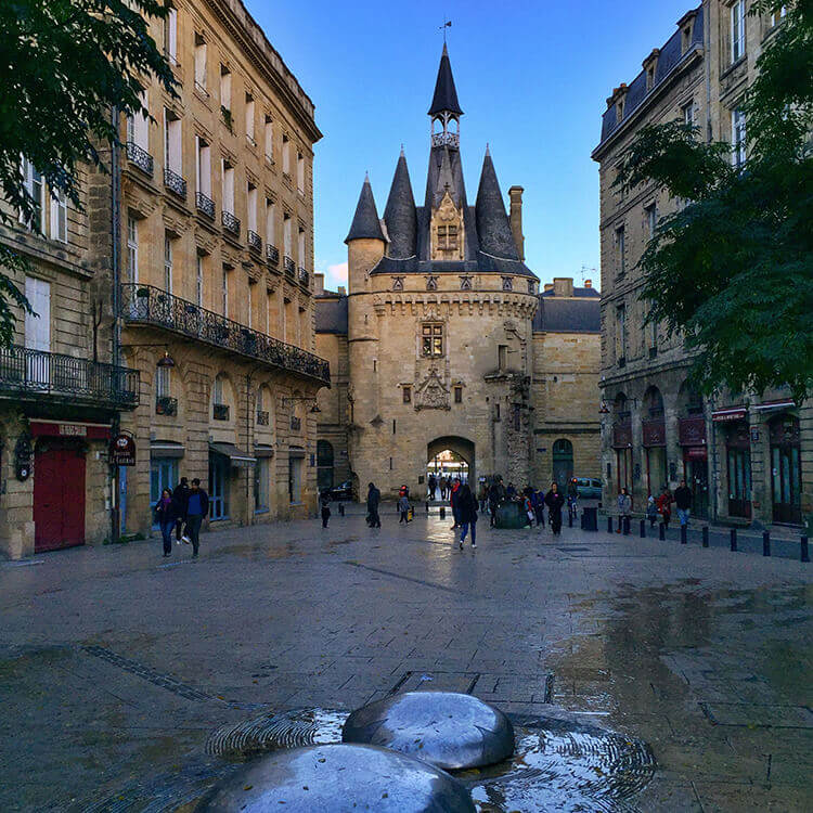 The castle-looking gate Port Cailhau on Place du Palais in Bordeaux, France