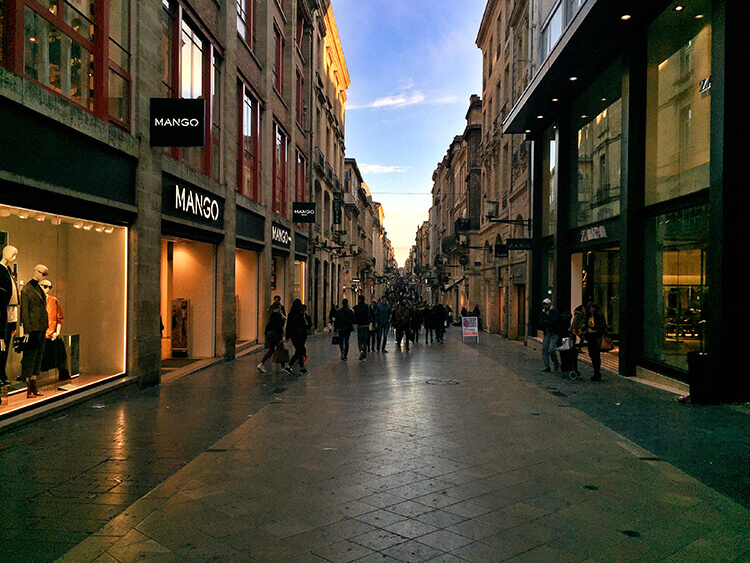 A sea of people shopping the shops lining the pedestrian Rue Saint Catherine in Bordeaux, France