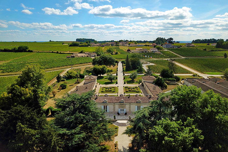 Drone aerial of Chateau Fombrauge surrounded by vinyeards