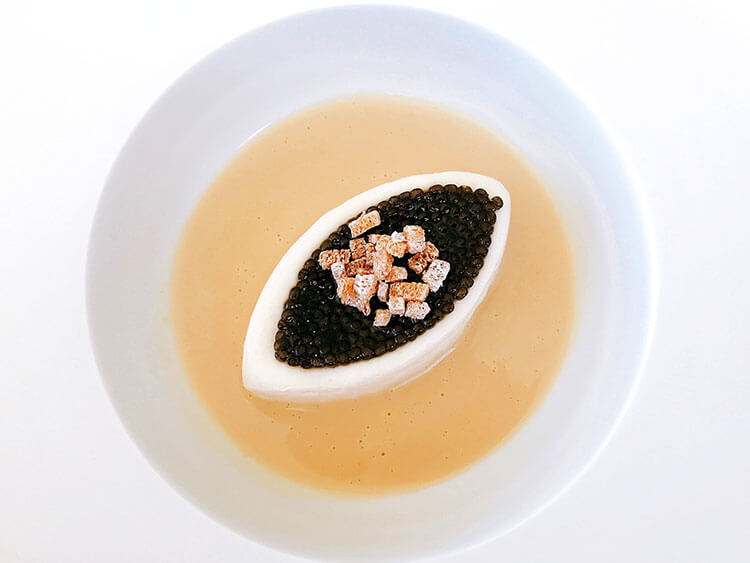 Cauilfower purée is molded into a football shape and topped with a layer of Beluga caviar and some croutons, then vodka sauce is poured in the bowl at Restaurant Lalique at Chateau Lafaurie Peyraguey