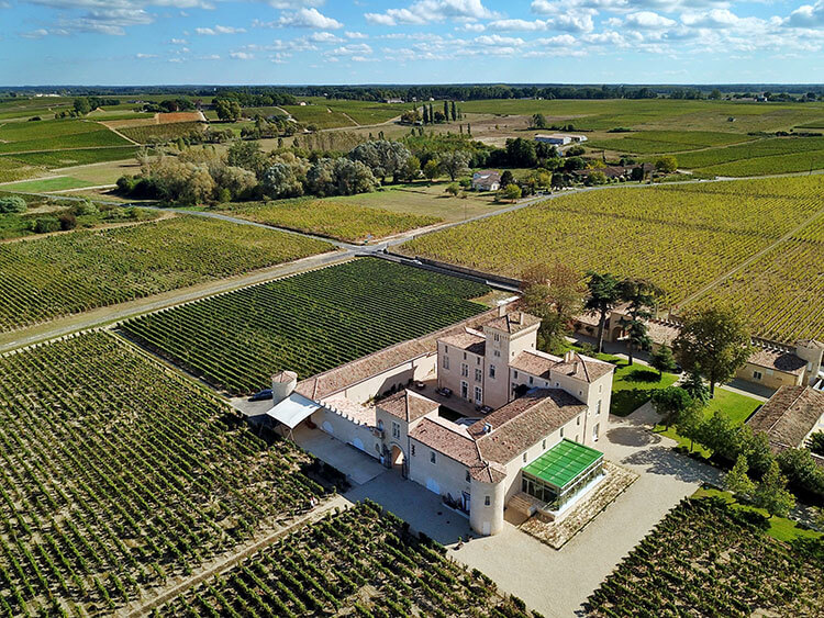 Aerial drone photo of the small castle and surrounding vineyards at Chateau Lafaurie Peyraguey