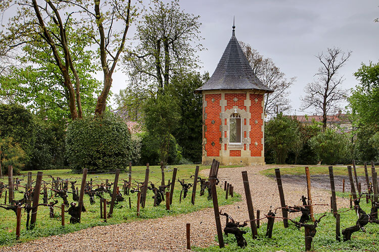 The red brick dovecote still in the gardens at Château Marquis de Terme