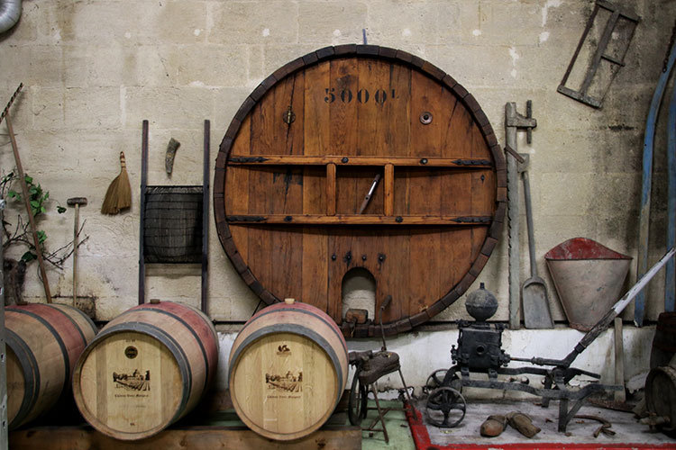 A collection of historic tools that were once used in the vineyards at Chateau Vieux Mougnac