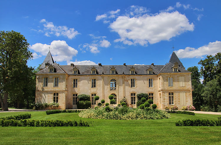 The castle of Reignac has two small towers on each end of the house and dates from the 16th century