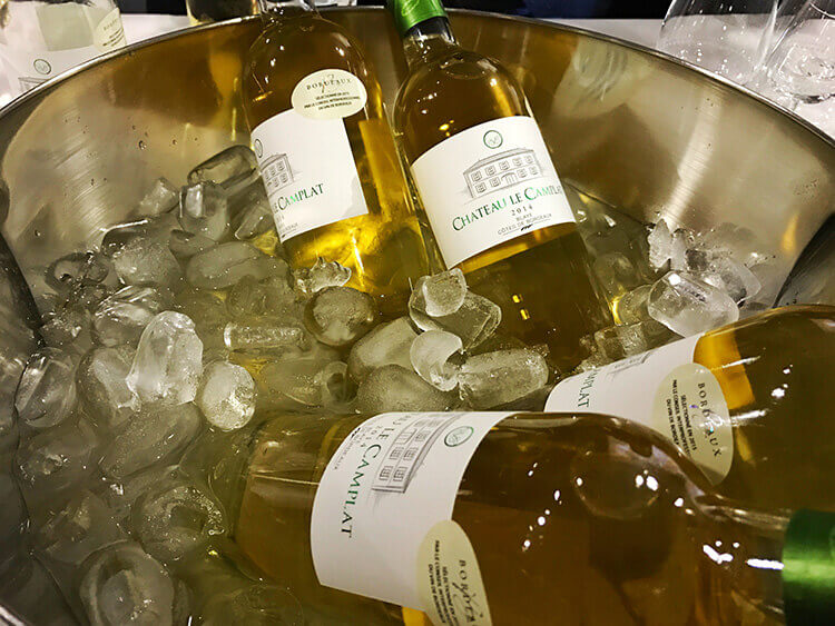 An ice bucket with the various wine selections of the evening at Cine Gourmand at La Cite du Vin
