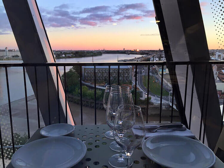 Sunset view of the Garonne River and Bordeaux from Le 7 Restaurant at La Cité du Vin