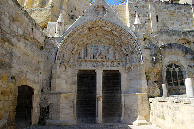 Ornately carved entrance to the Monolithic Church in Saint-Émilion