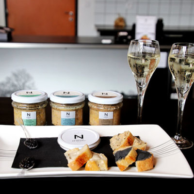 The tasting at Caviar de Neuvic with spoons of caviar, Sturgeon rillettes on baguette and caviar butter on baguette