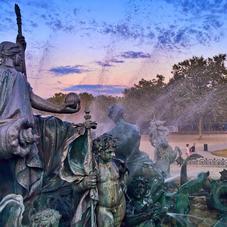 Close up of the Monument aux Girondins with the water fountain spraying up at sunset