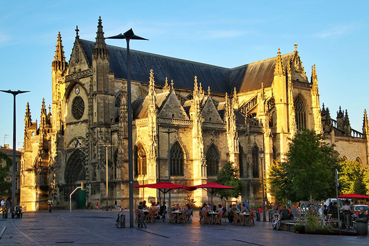 The gothic Basilica of Saint-Michel glows golden at sunset