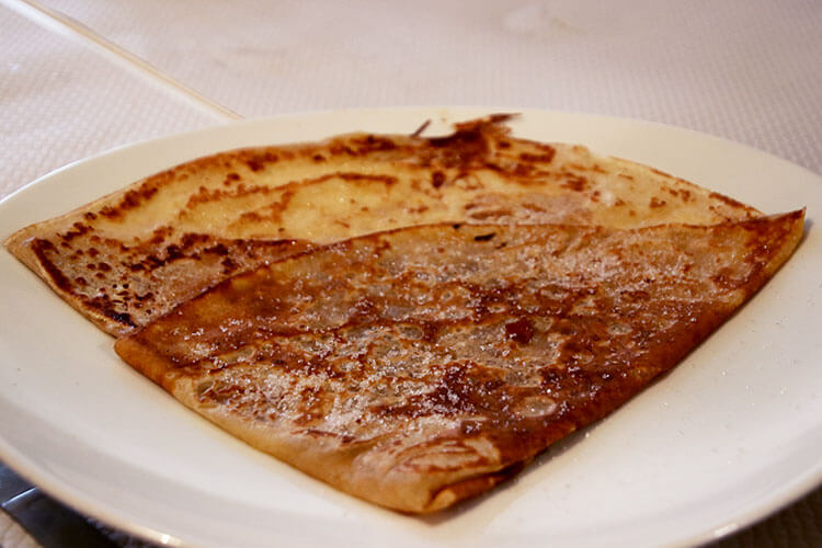 A classic sweet crêpe with butter and suger folded into a triangle at Ballet Christophe in Bordeaux