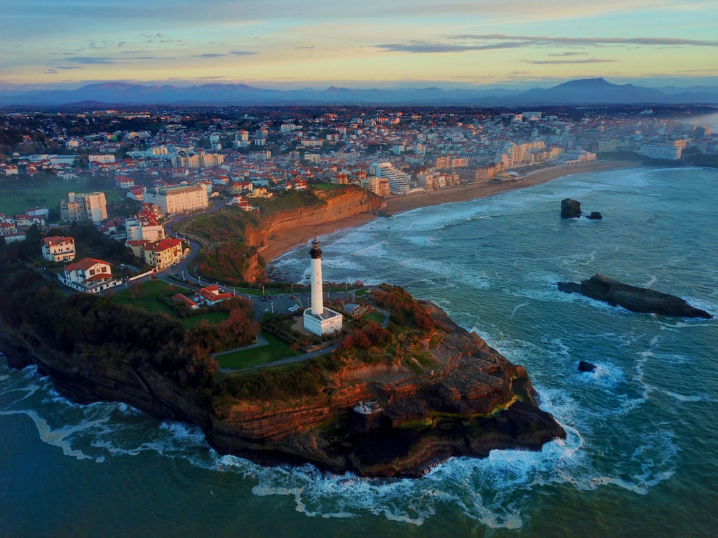 Drone photo of the Biarritz Lighthouse and sunset colors along the Grand Plage