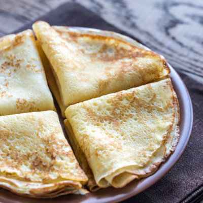 A plat of crêpes folded into triangles