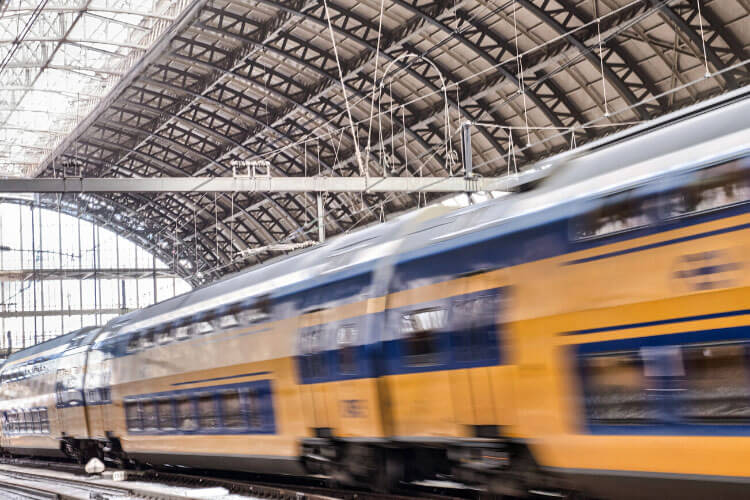A train blurs by in the Gare de Bordeaux-Saint-Jean
