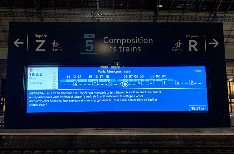 A screen on the platform displaying the layout of the train with the location of each coach