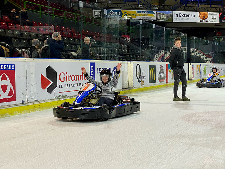 Jennifer sitting in her ice kart at the finish of the race cheering