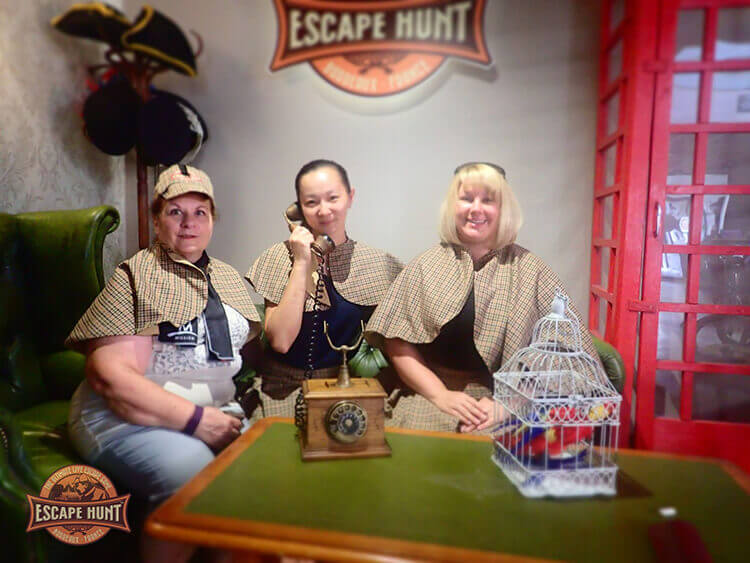 Jennifer posing with her mom and a friend after playing Bordeaux Escape Hunt