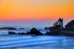 The sky in oranges and pinks from the Cote des Basques beach in Biarritz