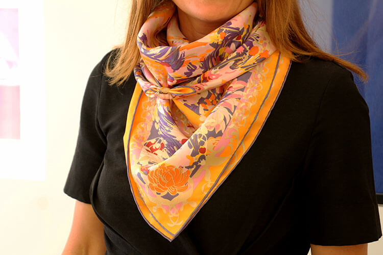 Learning to tie scarves in different configurations like this bandana style