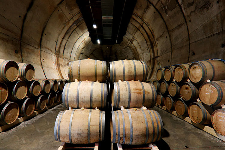 Wine barrels inside the diesel fuel bunker at Moon Harbour Distillery