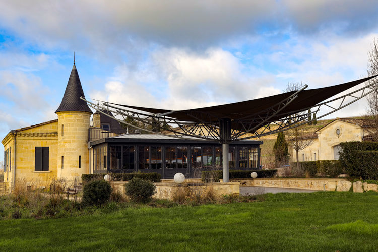 "The little castle where the Atelier de Candale restaurant is house at Château de Candale with a recent glass ""greenhouse"" addition so you can feel like you're dining in the vineyard"