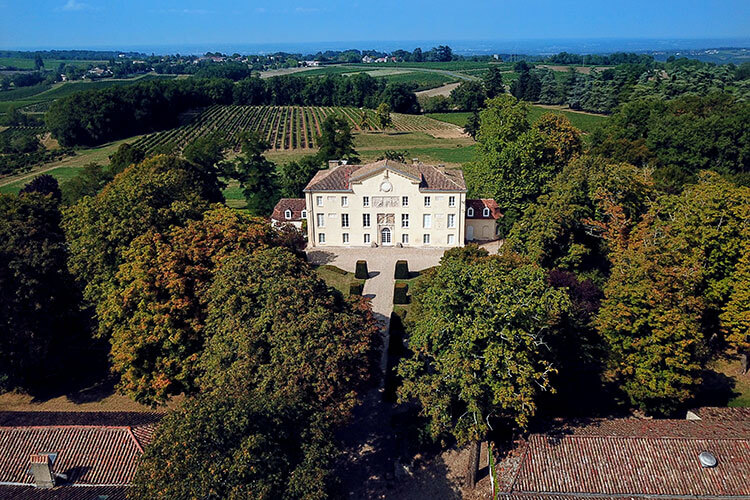 A drone aerial of the castle of Château de la Jaubertie, which is today a listed historical monument