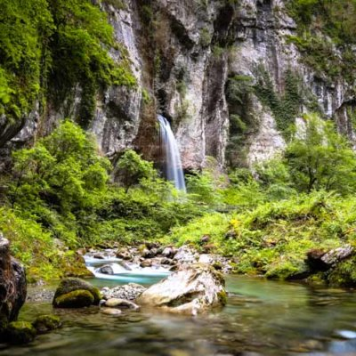 The 20 meter waterfall drops in to the stream in the Gorges de Kakuetta