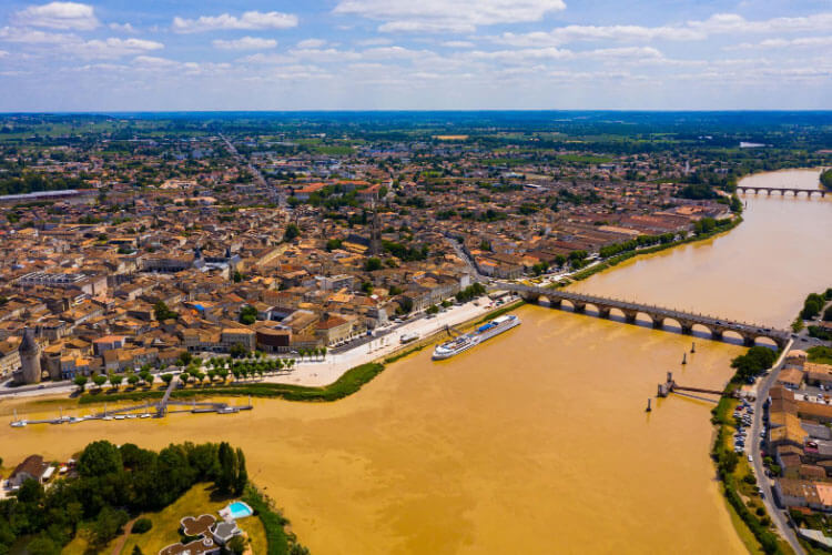 An aerial view of the confluence of the Dordogne and Isle rivers with Libourne's medieval monuments